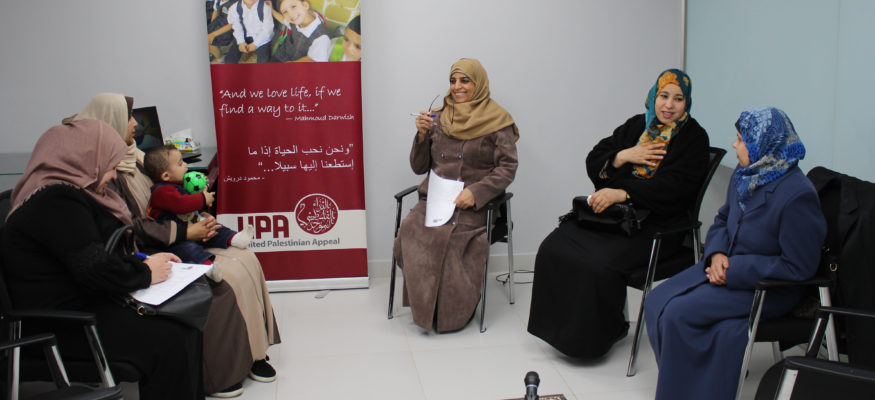 Gaza mental health practitioners hold a session for parents.