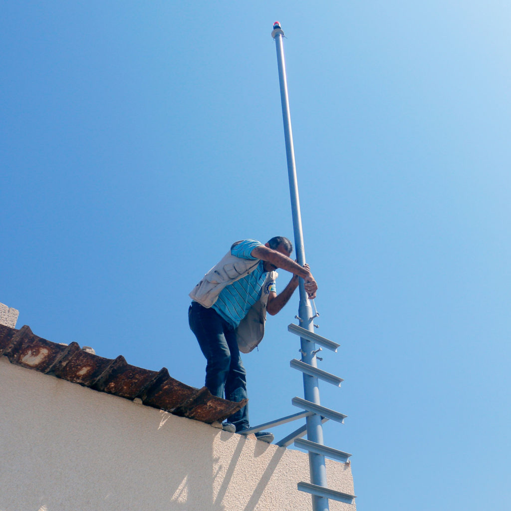 Installing a solar light in Gaza.