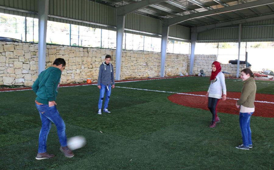 Palestinian Children playing soccer in Lebanon.