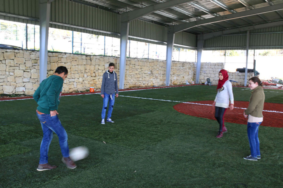 Palestinian Children playing soccer in Lebanon.
