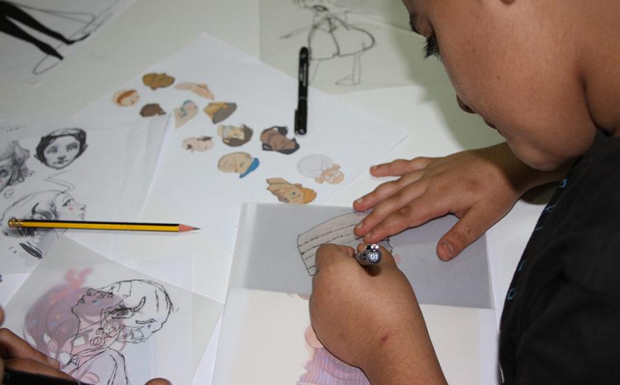 A child sketches in Lebanon.